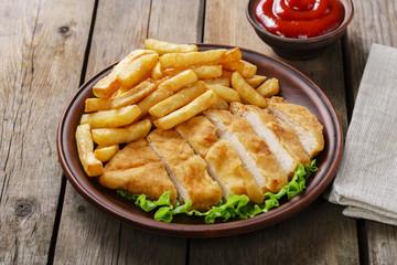 breaded chicken schnitzel with potatoes