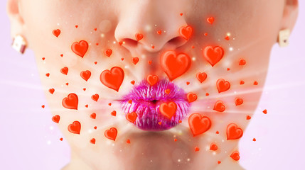Pretty lady lips with lovely red hearts