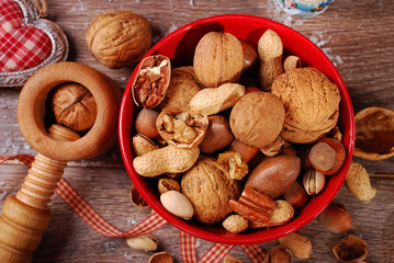 nuts assortment in bowl on wooden table for christmas