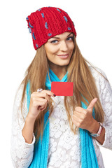 Winter woman with credit card showing thumb up