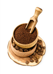 Ground coffee and beans in a wooden bowl