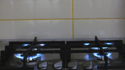 Gas stove with burning flame