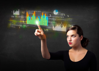 Young business woman touching colorful charts and diagrams