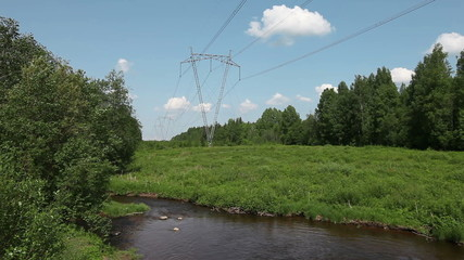 High-voltage line of electricity transmissions on field