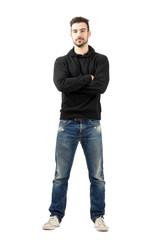 Confident man with crossed folded arms