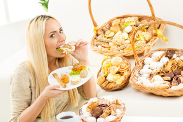 Blonde Girl Eats Pastry