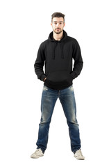 Confident man in hood with hands in pockets