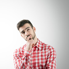 Portrait of thinking man looking up
