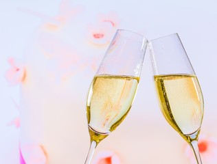champagne flutes on wedding cake background