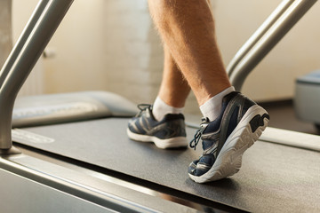 Exercising on treadmill.