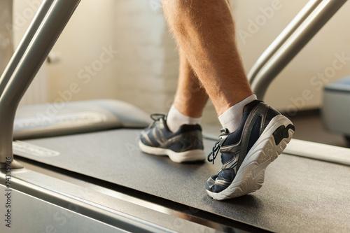 Exercising on treadmill. - 74335736