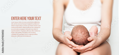newborn baby in lap - 74336132