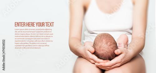 Leinwanddruck Bild newborn baby in lap