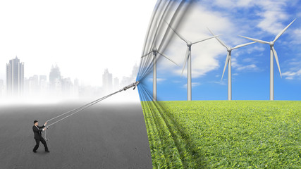 businessman pull open wind turbines curtain covering gray citysc