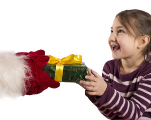 Santa Claus is giving a Christmas gift to child