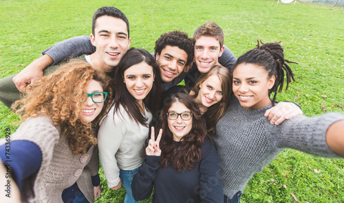 Multiethnic Group of Friends Taking Selfie at Park - 74336928