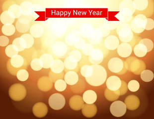 Happy New Year ribbon on gold bokeh background.