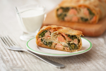 piece savory strudel with fish and spinach