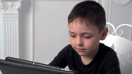 boy playing in the tablet, slow motion, dolly 1