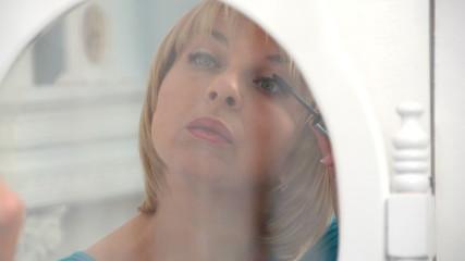 beautiful woman paints eyelashes, dolly, slow motion  2