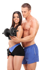 Attractive couple exercising with a weight