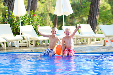 Two boys having fun in swimming pool