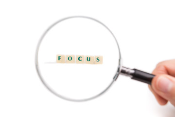 Concept of business idea focus. Magnifying glass.