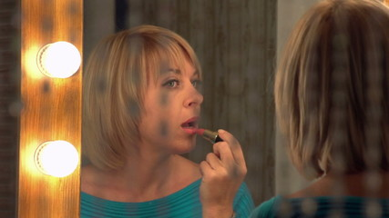 beautiful woman paints her lips, slow motion, dolly 3