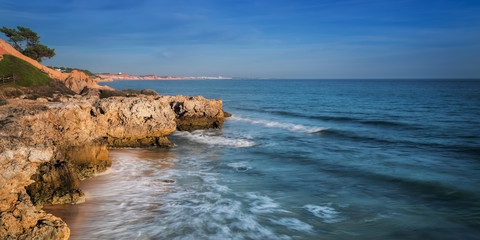 Sea surf in Albufeira beach and mountain in Portugal. Algarveю