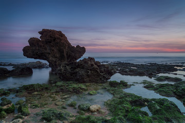 Beautiful sea sunset on a background elegant stone.