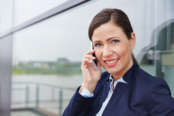 Business woman making phone call with smartphone