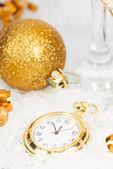 Old golden clock close to midnight and Christmas decorations