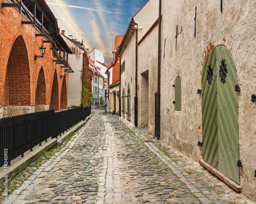 Narrow medieval street in old Riga city, Latvia, Europe - 74340903