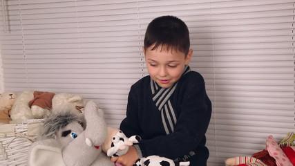 boy playing with soft toys, Nikolaev, Ukraine 1
