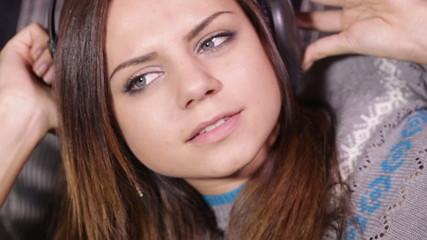 Girl with headphones sofa relax
