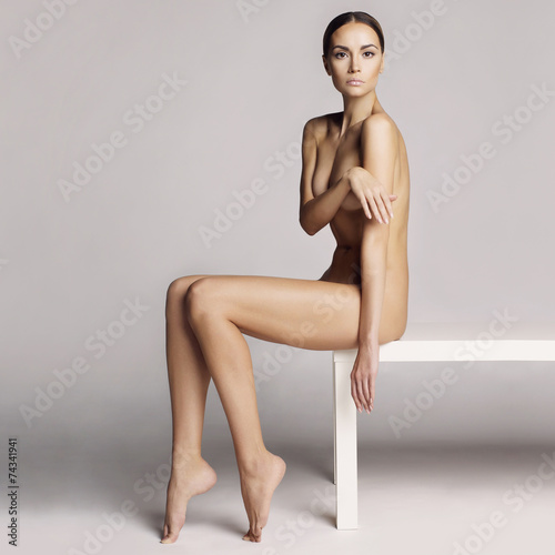 Elegant sitting lady - 74341941