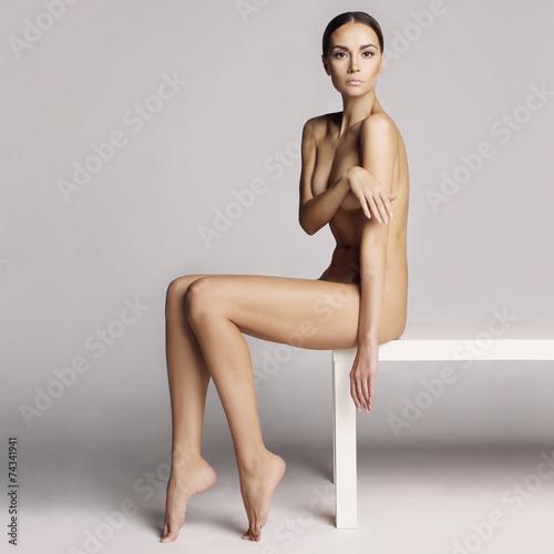 Keuken foto achterwand Akt Elegant sitting lady
