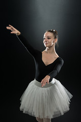 Portrait Of Beautiful Elegant Ballerina On Black Background