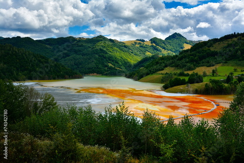 red  polluted lake  in Romania, Geamana - 74342780