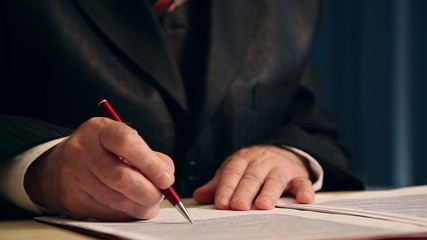 businessman working with documents, close-up of hands 1