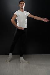 Portrait Of Young Ballet Dancer On Black Background