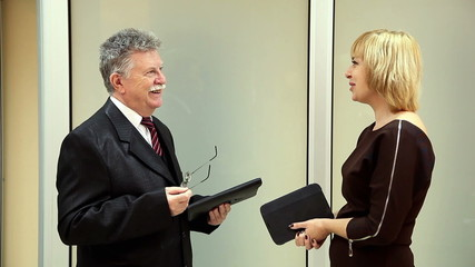 beautiful woman and elderly businessman talking