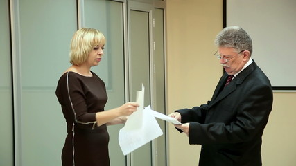 beautiful woman and elderly businessman swear in the office