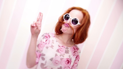 Young Woman Wearing Sunglasses Pose For The Camera