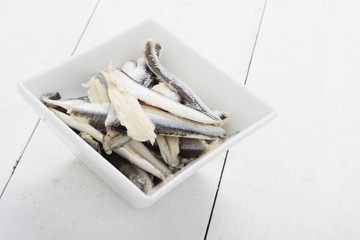 pickled anchovies in white dish