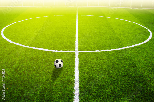 Zdjęcia na płótnie, fototapety, obrazy : Soccer ball on the field