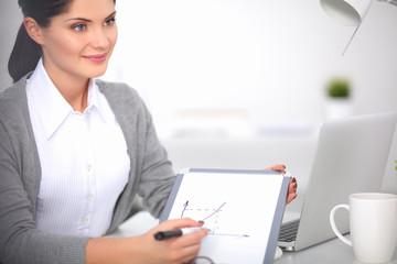 Beautiful businesswoman handing over paperwork extending her