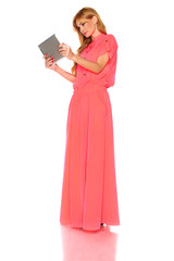 Girl in pink dress with tablet computer