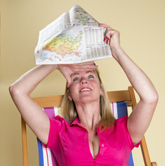 Holidaymaker reading the weather report