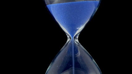 Hourglass against a black background. 3840X2160 4K UHD video